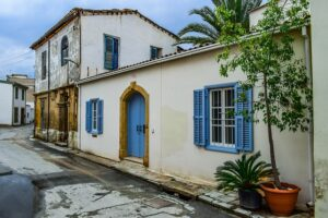 Traditional architecture of a white house with a blue door and blue windows in Nicosia